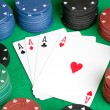 Four aces and poker stacked chips of many colors — Stock Photo