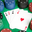 Stock Photo: Four aces and poker stacked chips of many colors