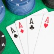 Four aces and poker stacked chips — Stock Photo #9437911