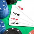 Stock Photo: Four aces and poker stacked chips
