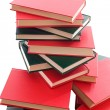Many books stacked on a white background — Stock Photo