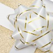 Beautiful golden gift — Stock Photo #9438136