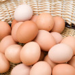 Basket with a lot of hen eggs - Stock fotografie