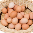 Basket with a lot of hen eggs — Stock Photo #9438431
