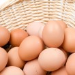Basket with a lot of hen eggs — Stock Photo