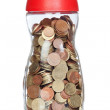 Glass bottle full of coins — Stockfoto