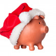 Piggy bank with Santa Claus hat — Stock Photo