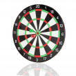 Stock Photo: Red and green darts punctured in the center