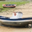 Boat and little fishing ship on the sand with low tide — Stock Photo #9438965