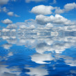 Blue sky reflected - Stock Photo