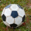 Old soccer ball - Stock Photo