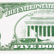 Part of a five dollar bill - Stock Photo