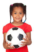 African little girl with a soccer ball — Stock Photo