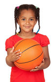 African little girl with a basket ball — Stock Photo