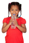 African little girl with water bottle — Stock Photo