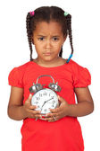 Sad little girl with a silvered clock — Stock Photo