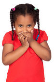 African little girl covering the mouth — Stock Photo