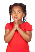 Sad little girl praying for something — Stock Photo