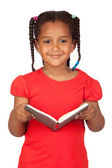 African little girl reading a book — Stock Photo