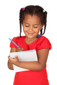 African little girl with a notebook — Stock Photo