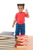 Adorable african baby with many books — Stock Photo