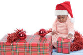 Baby girl with christmas presents — ストック写真