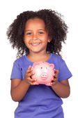 Adorable african little girl with piggy-bank — Stock Photo