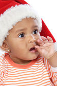 Baby girl with santa hat — Stockfoto