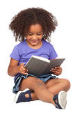 Student little girl reading with a book — Stock Photo
