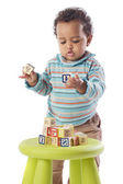 Baby playing with small pieces — Stock Photo