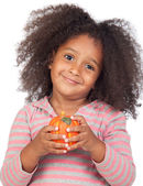 Adorable african little girl with beautiful hairstyle with a pum — Stock Photo