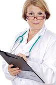 Female doctor senior writing — Stock Photo