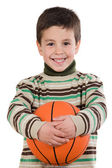 Adorable boy student with basketball — Stock Photo