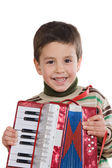 Adorable child playing red accordion — Stock Photo