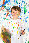 Little child playing with painting — Stock Photo