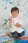Funny little boy with his face painted — Stock Photo