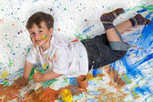Boy playing with painting — Stok fotoğraf