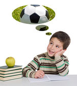Funny guy in class thinking about playing soccer — Stock Photo