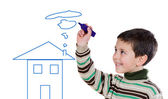 Adorable boy drawing a house — Stock Photo