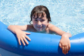 Adorable little boy in the swimming-pool — Stok fotoğraf