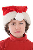 Funny boy with red hat of Christmas pulling a face — Stock Photo