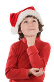 Adorable boy with red hat of Christmas — Stock Photo
