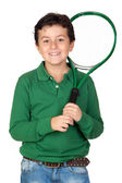Adorable child with a tennis racket — Stock Photo