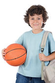 Student boy blond with a basketball — Stock Photo