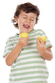 Eating a lemon — Stock Photo