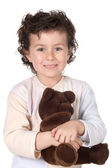 Pretty boy in pajamas with teddy bear — Stock Photo