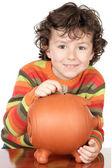 Chłopiec odrobina skarbonka — Zdjęcie stockowe