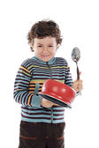 Naughty boy making noise with a saucepan — Stock Photo
