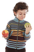 Child with eating two apples — Stock Photo