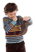 Boy with stinky shoe — Stock Photo